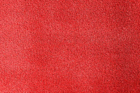 Bright red carpet as background, top view