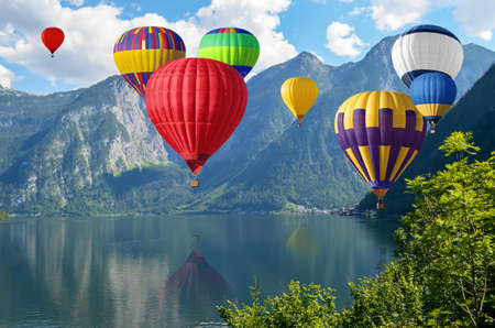 Mountain landscape and flying air balloons over river: Royalty ...
