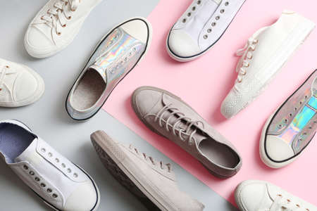 Photo pour Flat lay composition with different sneakers on color background - image libre de droit
