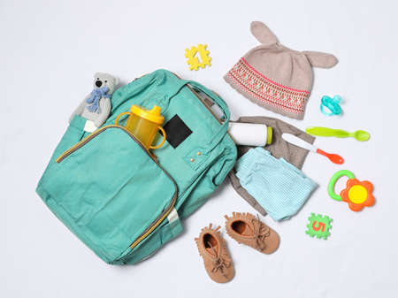 Photo pour Composition with maternity backpack and baby accessories on white background, top view - image libre de droit