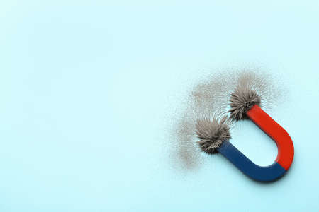 Photo for Magnet with iron powder on color background, top view. Space for text - Royalty Free Image