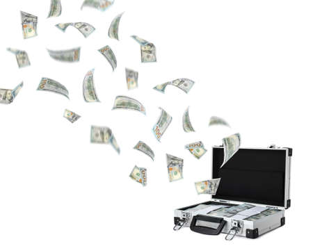 Modern suitcase and flying American dollars on white background