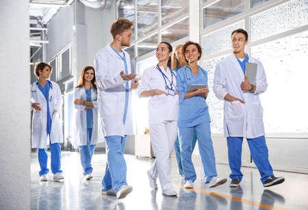 Photo pour Group of medical students in college hallway - image libre de droit