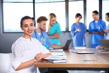 Photo pour Smart medical student with her classmates in college - image libre de droit