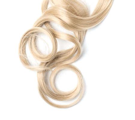 Foto de Curly blond hair on white background, top view. Hairdresser service - Imagen libre de derechos