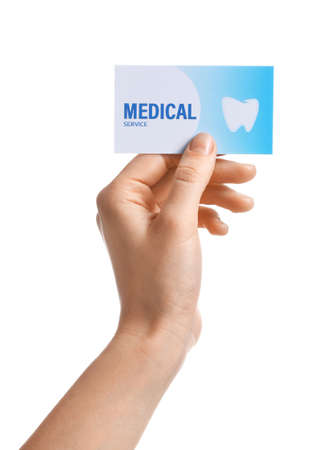 Photo pour Woman holding business card isolated on white, closeup. Dental medical service - image libre de droit
