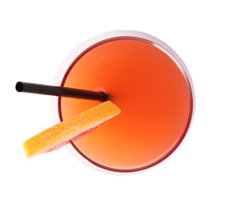 Glass of grapefruit cocktail isolated on white, top view