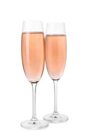Foto de Glasses of rose champagne isolated on white - Imagen libre de derechos