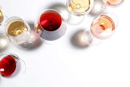 Photo pour Different glasses with wine on white background, top view - image libre de droit