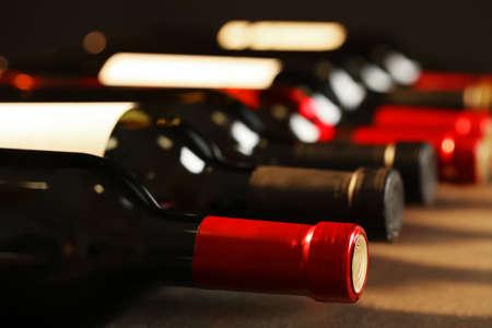 Photo pour Bottles of different wines, closeup. Expensive collection - image libre de droit