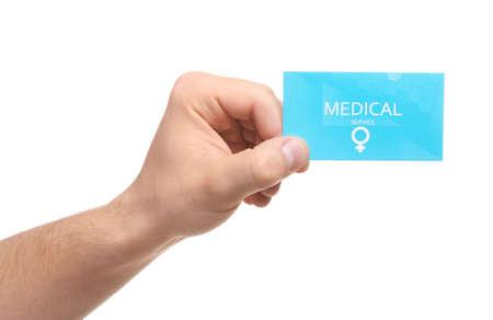 Photo pour Man holding medical business card isolated on white, closeup. Women's health service - image libre de droit