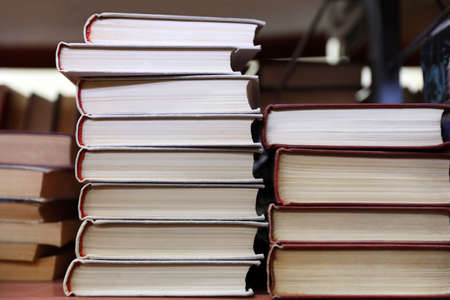 Photo pour Stacks of books on shelf in library - image libre de droit