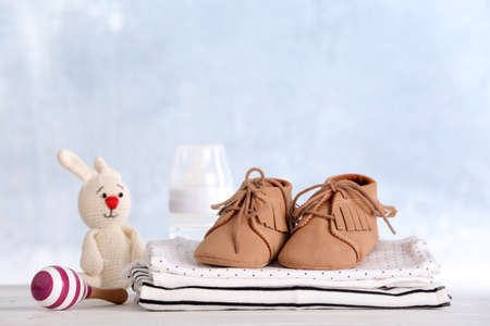 Photo for Set with baby accessories on table against light background - Royalty Free Image