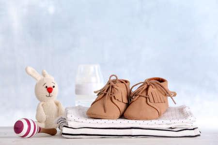 Photo pour Set with baby accessories on table against light background - image libre de droit