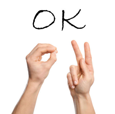 Photo for Man showing word OK on white background, closeup. Sign language - Royalty Free Image