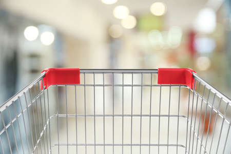Empty shopping basket on blurred background, closeup