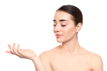 Photo pour Portrait of young woman with beautiful face against white background - image libre de droit