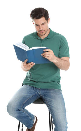 Photo for Handsome man reading book on white background - Royalty Free Image