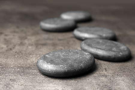 Photo pour Spa stones on grey background. Space for text - image libre de droit