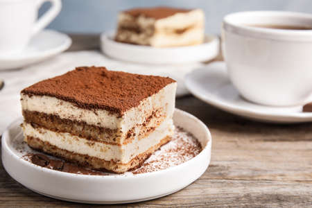 Photo for Composition with tiramisu cake and tea on table, closeup. Space for text - Royalty Free Image