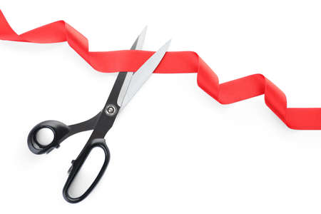Photo pour Stylish scissors and red ribbon on white background. Ceremonial tape cutting - image libre de droit