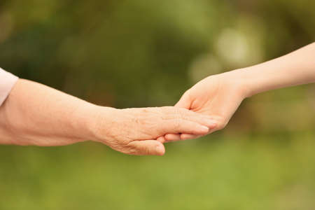 Foto de People, care and support. Giving helping hand concept - Imagen libre de derechos