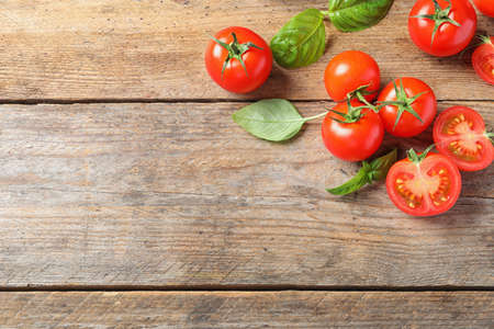 Photo for Fresh cherry tomatoes on wooden background, flat lay. Space for text - Royalty Free Image