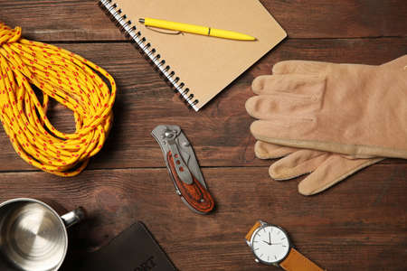 Photo pour Flat lay composition with camping equipment on wooden background - image libre de droit