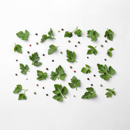 Flat lay composition with green parsley and pepper on white backgroundの写真素材