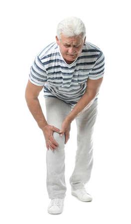 Full length portrait of senior man having knee problems on white background