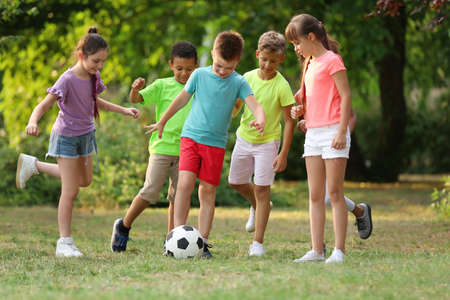 Photo for Cute little children playing with soccer ball in park - Royalty Free Image