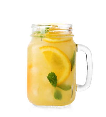 Photo pour Mason jar of orange refreshing drink with mint on white background - image libre de droit