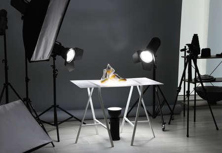 Photo pour Professional photography equipment prepared for shooting stylish shoes in studio - image libre de droit