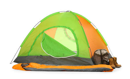 Photo pour Comfortable colorful camping tent with sleeping bag and boots on white background - image libre de droit