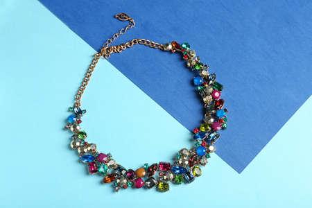 Photo pour Elegant necklace on color background, top view. Luxury jewelry - image libre de droit
