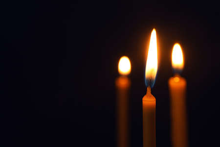 Photo for Burning candles on dark background, space for text. Symbol of sorrow - Royalty Free Image
