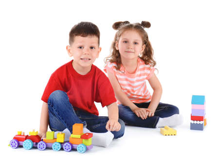 Photo pour Cute little children playing with toys on white background - image libre de droit