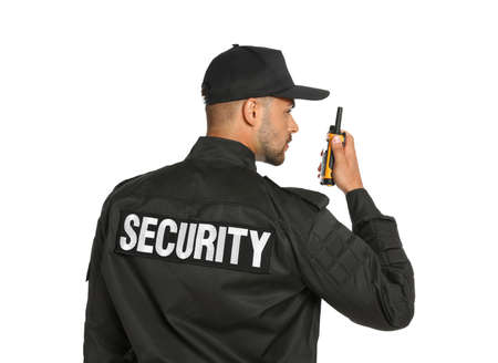 Photo for Male security guard in uniform using portable radio transmitter on white background - Royalty Free Image
