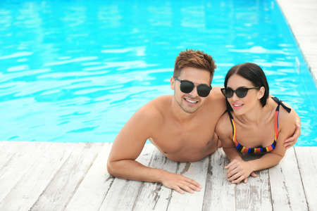Photo for Woman in bikini with boyfriend at resort. Happy young couple - Royalty Free Image