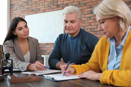 Photo pour Female notary working with mature couple in office - image libre de droit