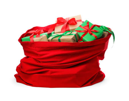 Photo for Santa Claus red bag full of presents isolated on white - Royalty Free Image