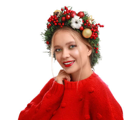Photo for Beautiful young woman wearing Christmas wreath on white background - Royalty Free Image