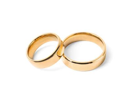 Photo pour Shiny gold wedding rings on white background - image libre de droit
