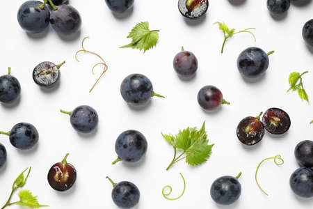 Foto de Fresh ripe juicy grapes on white background, top view - Imagen libre de derechos