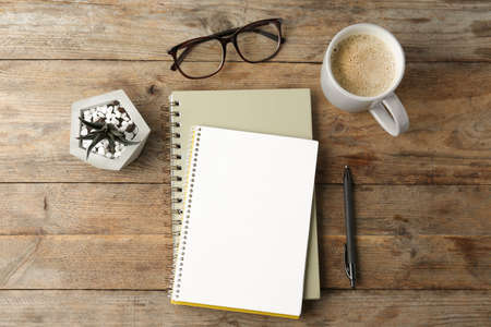 Photo for Flat lay composition with office stationery and cup of coffee on wooden table. Space for design - Royalty Free Image