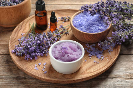 Photo for Plate with natural cosmetic products and lavender flowers on wooden table - Royalty Free Image