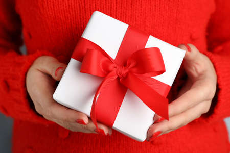 Photo for Young woman holding Christmas gift, closeup view - Royalty Free Image