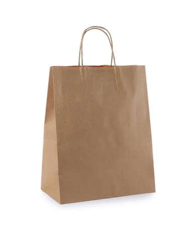 Photo pour Empty craft paper bag isolated on white. Mockup for design - image libre de droit