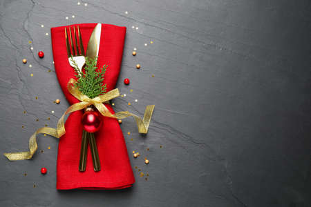 Photo pour Cutlery set on grey table, top view with space for text. Christmas celebration - image libre de droit