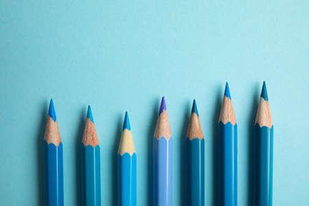 Photo pour Flat lay composition with color pencils on light blue background - image libre de droit